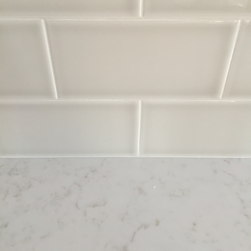herringbone-tile-and-quartz-countertops