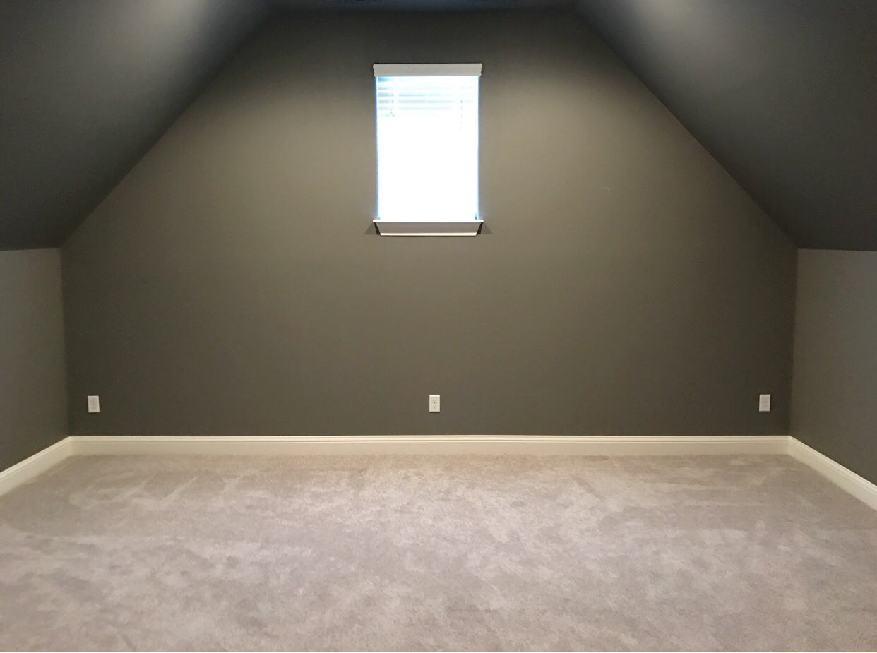 It was originally intended to be a movie room with dark walls hence the dark gray walls and ceilings of course with any new space it takes living in it
